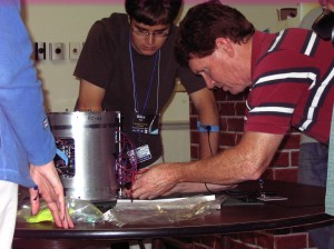 Helferty (right) puts the final touches on his group's payload before launch